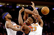 NEW YORK, NEW YORK - FEBRUARY 12:  Ian Mahinmi #28 of the Washington Wizards passes the ball under pressure from Maurice Harkless #3 and Mitchell Robinson #23 of the New York Knicks in the second half at Madison Square Garden on February 12, 2020 in New York City.The Washington Wizards defeated the New York Knicks 114-96. NOTE TO USER: User expressly acknowledges and agrees that, by downloading and or using this photograph, User is consenting to the terms and conditions of the Getty Images License Agreement. (Photo by Elsa/Getty Images)