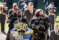 Pall Bearers carrying the coffin of the Duke of Edinburgh, followed by (left to right, first row) the Prince of Wales, Princess Anne, ((left to right, second row) the Duke of York, the Earl of Wessex, ((left to right, third row) the Duke of Cambridge, Peter Phillips, (left to right, fourth row) the Duke of Sussex, the Earl of Snowdon and (back) Vice Admiral Sir Timothy Laurence, entering St George's Chapel, Windsor Castle, Berkshire. Picture date: Saturday April 17, 2021.