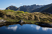 Images from the Lofoten Islands in arctic Norway at midsummer. Small lake seen hiking above Sørvågen
