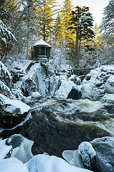 Dunkeld, Scotland, UK. 11 Feb 2021.  Winter view in thick snow of Ossian's Hall overlooking the Black Linn Falls on the River Braan at The Hermitage forest near Dunkeld in Perthshire. Iain Masterton/Alamy Live news