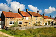 Traditional stone houses of Hutton Le Hole, North Yorks Moors National Park, Yorkshire, England .<br /> <br /> Visit our ENGLAND PHOTO COLLECTIONS for more photos to download or buy as wall art prints https://funkystock.photoshelter.com/gallery-collection/Pictures-Images-of-England-Photos-of-English-Historic-Landmark-Sites/C0000SnAAiGINuEQ