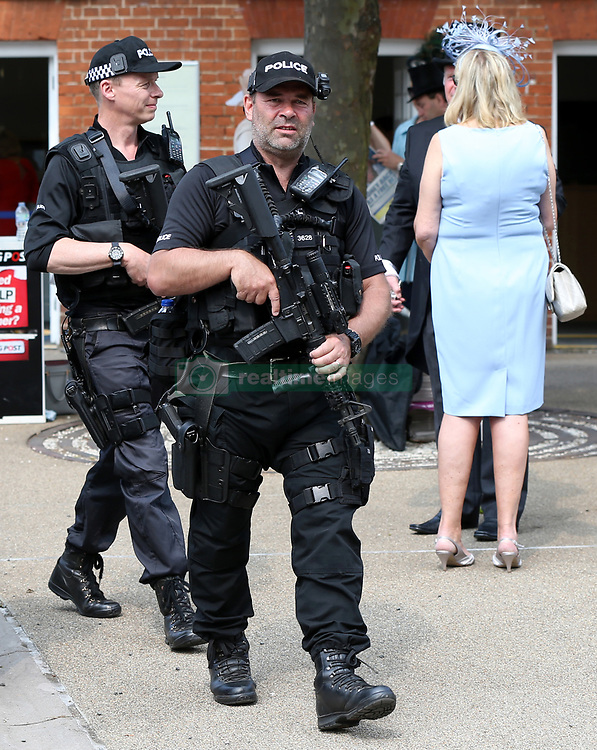 Armed police arrive at the entrance to Royal Ascot Races during day one of Royal Ascot at Ascot Racecourse.