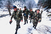 US Army Special Forces work with a Serb military unit to establish the Zone of Seraration (ZOS) between the warring armies. Using satellite technology the US forces aided in drawing up the bounderies between Serb, Croatian, and Muslim forces.