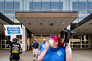 25 AUGUST 2020 - DES MOINES, IOWA: CALLIE BATES, a postal worker, leads a chant to support the USPS during a rally at the Neal Smith Federal Building in Des Moines. About 100 people, postal workers and members of the public, came to the Neal Smith Federal Building Tuesday to call for increased spending for the US Postal Service and an end to attacks on the USPS by members of the Trump administration. The rally was a part of a series national rallies organized by the American Postal Workers Union (APWU). Many of the people at the rally expressed concerns that the President's actions versus the USPS could harm their ability vote by mail in the November general election.     PHOTO BY JACK KURTZ