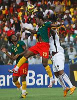 Photo: Steve Bond/Richard Lane Photography.<br />Ghana v Cameroon. Africa Cup of Nations. 07/02/2008. Andre Bikey (C) gets above Junior agogo (R). Alexandre Song (L) looks on