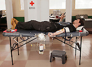 Amiel Maerling of Greenfield Park checks his cell phone while donating blood at Sullivan County Community College in Loch Sheldrake on Tuesday, Feb. 8, 2011.