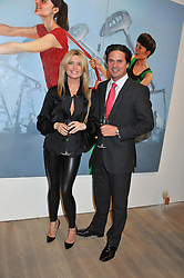 TINA HOBLEY and OLIVER WHEELER at a private view of Fly to Baku - Contemporary Art from Azerbaijan held at Phillips de Pury, Howick Place, London SW1 on 17th January 2012.