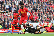 Daniel Sturridge of Liverpool gets away from Curtis Davies of Hull City. Premier League match, Liverpool v Hull City at the Anfield stadium in Liverpool, Merseyside on Saturday 24th September 2016.<br /> pic by Chris Stading, Andrew Orchard sports photography.