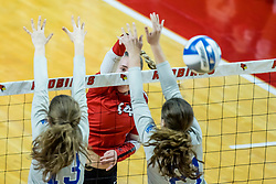 BLOOMINGTON, IL - October 23: Sarah Kushner  hits past Audrey Dennison during a college Women's volleyball match between the ISU Redbirds and the Drake Buldogs on October 23 2021 at Illinois State University in Normal, IL. (Photo by Alan Look)