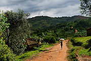 A woman walking in Butare, Rwanda on March 25, 2013. The Simbi Area Development Program (ADP) is one of several new a new ADP initiatives in Rwanda led by the international nonprofit World Vision. Area Development Programs provide developmental resources for communities to promote long-term, sustainable improvements to the economic and physical well being of a community.