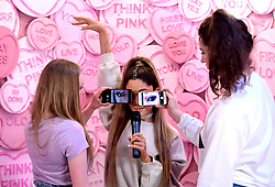 Heather (left) and Grace take pictures of the waxwork of Ariana Grande at the unveiling of Ariana Grande's wax figure at Madame Tussauds, London.