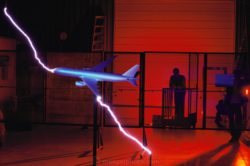 High voltage long arc discharge to a Boeing prototype jet airliner scale model. On average, commercial airliners are hit once a year by lightning causing slight damage where the current enters and exits. Lightning Technologies, Inc., Pittsfield, Massachusetts. (1992)