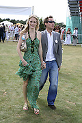 Poppy Delevigne and Dan Philipson, Cartier International Polo. Guards Polo Club. Windsor Great Park. 30 July 2006. ONE TIME USE ONLY - DO NOT ARCHIVE  © Copyright Photograph by Dafydd Jones 66 Stockwell Park Rd. London SW9 0DA Tel 020 7733 0108 www.dafjones.com