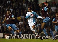 Photo: Tony Oudot.<br /> Tottenham Hotspur v Aston Villa. The FA Barclays Premiership. 01/10/2007.<br /> Dimitar Berbatov of Tottenhamgoes past Garet Barry and Zak Knight of Aston Villa