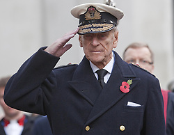The Duke of Edinburgh salutes during a visit to the Field of Remembrance at Westminster Abbey to remember Britain's war dead.