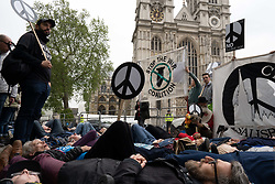 May 3, 2019 - London, United Kingdom - Anti-nuclear activists protest by lying on ground  outside Westminster Abbey during the Thanksgiving service for the Navy. (Credit Image: © Lexie Harrison-Cripps/SOPA Images via ZUMA Wire)