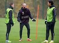 22/10/14 <br /> CELTIC TRAINING<br /> Celtic's Jo Inge Berget (centre) shares a joke with team-mate Virgil van Dijk (right)