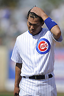 MESA, AZ - MARCH 6:  Kosuke Fukudome #1 of the Chicago Cubs wipes his brow during the game against the Chicago White Sox on March 6, 2010 at HoHoKam Park in Mesa, Arizona. (Photo by Ron Vesely)