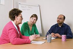 Focus group of people in a meeting,