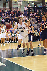 10 January 2009: Colleen Caplice works the baseline in an attempt to save the ball from out of bounds. The Lady Titans of Illinois Wesleyan University downed the and Lady Thunder of Wheaton College by a score of 101 - 57 in the Shirk Center on the Illinois Wesleyan Campus in Bloomington Illinois.