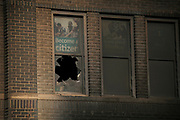 Soot and broken glass on the second floor of the Coliseum Building along Lake Street in Minneapolis, Minnesota on Monday, June 1, 2020.