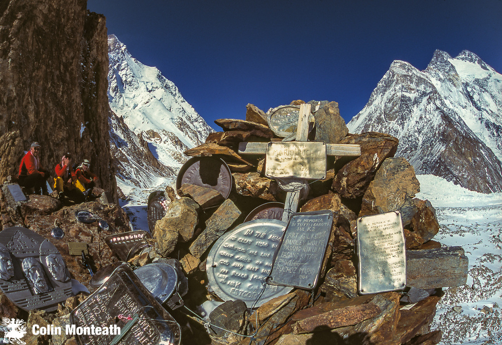 Gilkey memorial to climbers killed on K2, New Zealand skiers sit nearby after skiing up Baltoro and Godwin Austen glaciers to base of K2 - K2 on left, Broad Peak on right, Karakoram mountains, Pakistan
