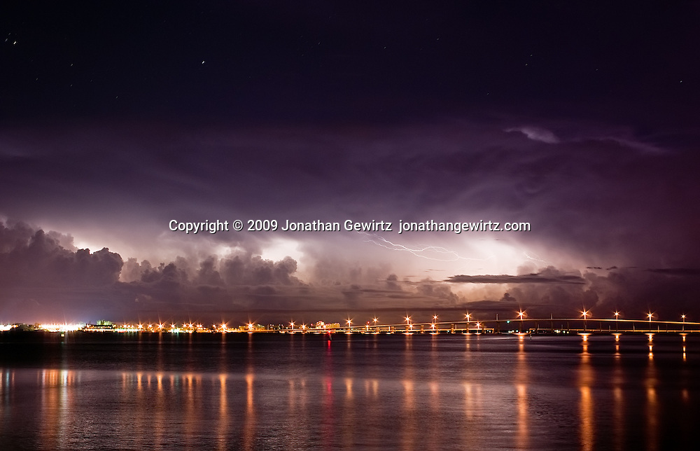 A dramatic pre-dawn thunderstorm over the Atlantic Ocean beyond Key Biscayne, as seen from the Brickell Key causeway in Miami. WATERMARKS WILL NOT APPEAR ON PRINTS OR LICENSED IMAGES.