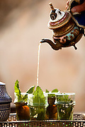 Fresh mint tea being poured, traditionally from a height, in Fes, Morocco