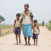 CAPTION: Locals walking the road to the OORJAgram Rural Enterprise Zone. LOCATION: Diara Rasulpur, Saran District, Bihar, India. INDIVIDUAL(S) PHOTOGRAPHED: From left to right - Nirala Kumar, Shivkumar, Lal Babu Rai and Bablu.