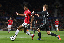 Manchester United's Marcus Rashford (left) and CSKA Moscow's Konstantin Kuchaev in action during the UEFA Champions League match at Old Trafford, Manchester.