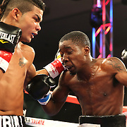 ORLANDO, FL - OCTOBER 04: Neslan Machado (L) punches Stephon McIntyre during a professional super lightweight boxing match at the Bahía Shriners Auditorium & Events Center on October 4, 2014 in Orlando, Florida. (Photo by Alex Menendez/Getty Images) *** Local Caption ***Neslan Machado; Stephon McIntyre