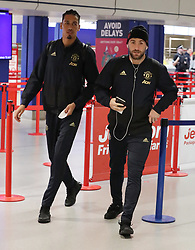 Chris Smalling and Luke Shaw are spotted on their way to catch a flight as the team fly to Turin on Tuesday afternoon to play Juventus in The Champions League on Wednesday night.