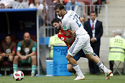 (l-r) Isco of Spain, Aleksandr Erokhin of Russia during the 2018 FIFA World Cup Russia round of 16 match between Spain and Russia at the Luzhniki Stadium on July 01, 2018 in Moscow, Russia