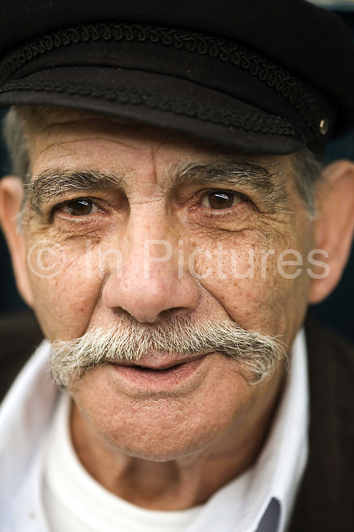 Portrait of an old man on a stall at the Mahane Yahuda Market, Jerusalem, Israel