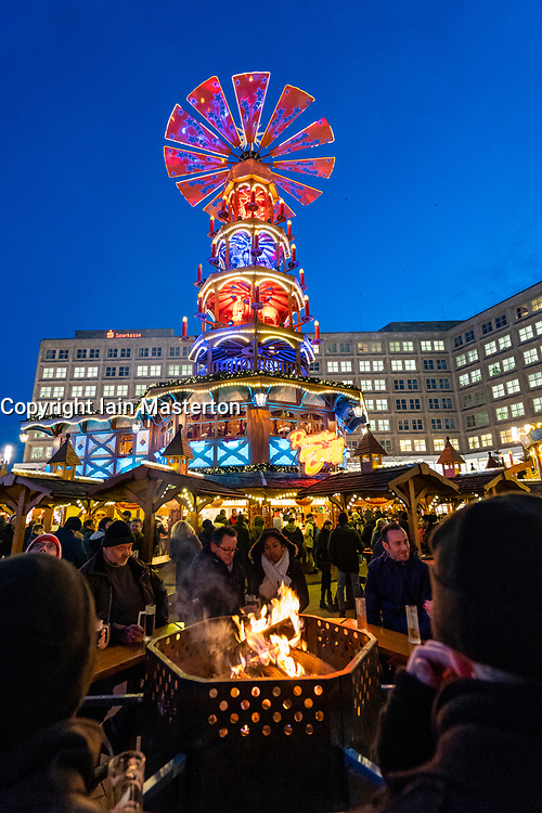 Traditional Christmas Market at Alexanderplatz in Mitte, Berlin, Germany. Pictured the Pyramiden Treff or Pyramid meeting place.