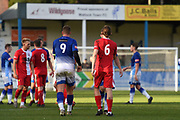 Liam Hughes of Matlock Town and Joshua Wilson of Ashton United walking over to acknowledge the others and to bless them a safe journey home during the Northern Premier League match between Matlock FC and Ashton United at the Proctor Cars Stadium on October 10th, 2020 in Matlock, Derbyshire.  Local fans welcomed to watch the match maintaining Government's Covid-19 guidelines. (VXP Photo/ Shaun Hardwick)
