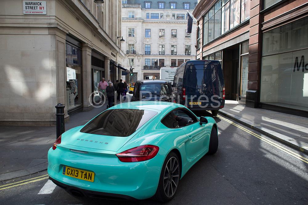 Aqua coloured Porsche car in central London, UK.