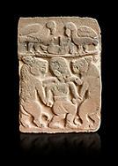 Pictures & images of the North Gate Hittite sculpture stele depicting man with wolves. 8the century BC.  Karatepe Aslantas Open-Air Museum (Karatepe-Aslantaş Açık Hava Müzesi), Osmaniye Province, Turkey. Against black background