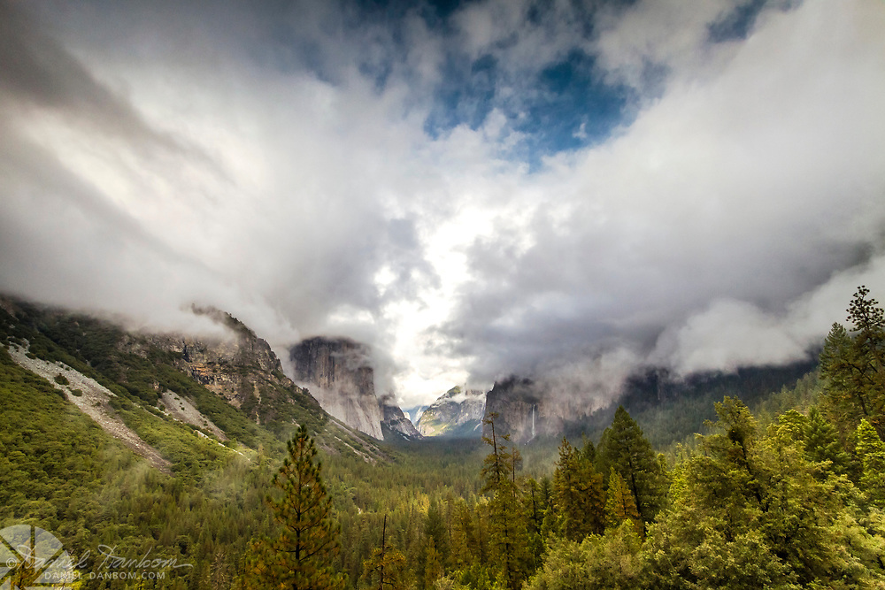 The view of Yosemite Valley from the tunnel view vista point, with dramtic sky and clouds.
