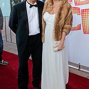 NLD/Rotterdam/20110925 - Premiere Daddy Cool, Robert Schoemacher en partner Claudia van Zweden