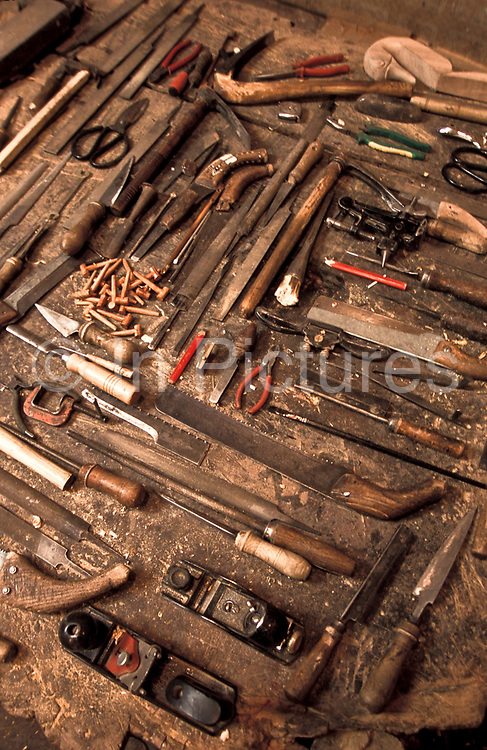 Detail of the wide variety of tools used to make traditional Uighur and other Muslim and Central Asian instruments: Rawap, Duttar, Tanbur, Huxtar, Gijek, etc.  in Kashgar city's most respected workshop, China