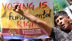 June 23, 2017 - Colombo, Sri Lanka - A Sri Lankan supporter of former president Mahinda Rajapakse shout slogans demanding the president Maithripala Sirisena led government to stop delaying the Local government elections during a protest in front of Ministry of provincial councils & Local government at Colombo, Sri Lanka on Friday 23 June 2017....After a brief discussion with the protesters & representatives of former government the Minister of Provincial Councils and Local Government, Faiszer Musthapha  announced that the Local Government election would be conducted in September. (Credit Image: © Tharaka Basnayaka/NurPhoto via ZUMA Press)