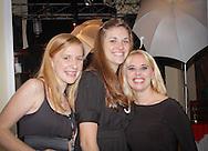 Three girl friends having fun at a party.