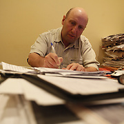 War reporter Vyacheslav Izmailov works at his office at the Novaya Gazeta newspaper in Moscow. Novaya Gazeta is one of the few remaining independent media outlets in Russia that dare to challenge the Kremlin, but it has paid a heavy price for its courage. Anna Politkovskaya, the newspaper's most prominent journalist, was gunned down in her apartment block in Moscow in 2006.   ..Picture by Justin Jin.