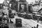 Cherbourg, 1940: Last equipment being loaded on board ships by the retreating British Expeditioary Force before France's great atlantic port was destroyed, thus denying its use to the approaching Germans.