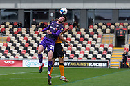 Tranmere Rover's Paul Lewis (22) competes for a high ball with Newport County's Mickey Demetriou (28) during the EFL Sky Bet League 2 match between Newport County and Tranmere Rovers at Rodney Parade, Newport, Wales on 17 October 2020.