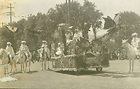 1909 Queen's float in the Hollywood Tilting & Floral Parade. Helen Somers is the Queen