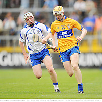 10 July 2011; Aaron Cunningham, Clare, in action against Stephen O'Neill, Waterford. Munster GAA Hurling Minor Championship Final, Clare v Waterford, Pairc Ui Chaoimh, Cork. Picture credit: Stephen McCarthy / SPORTSFILE