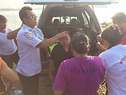 """SHOCKING picture shows emergency personnel save girl after she walked into the sea following an argument with her partner. <br /> <br /> A woman narrowly escaped drowning early this morning after she walked into the sea at Saphan Hin following an argument with her girlfriend.<br /> <br /> Lt Col Pongpichan Chayanonpiriya of Phuket City Police received reports of the incident at about 6:30am.<br /> <br /> """"We found a young woman at the scene, crying and calling out for 'Jip'. After searching the area for 30 minutes, rescue workers found the young woman on a broken old boat nearby,"""" said Col Pongpichan.<br /> <br /> Jip's girlfriend, whose name was withheld by police, said that the two of them had driven up to Saphan Hin and parked nearby to talk. They began arguing, after which Jip got out of the car and ran into the sea.<br /> <br /> """"Jip, after being rescued, told police that she was very angry with her girlfriend. She had walked about 200 meters from the shore when she got caught in some waves and was swept out. She also said that if it weren't for the boat, she would've ended up dead,"""" said the colonel.<br /> <br /> She was taken to Vachira Phuket Hospital for treatment.<br /> ©Phuket News/Exclusivepix Media"""
