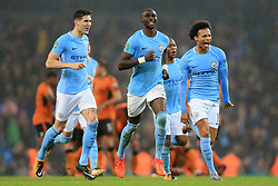 24th October 2017 - Carabao Cup (4th Round) - Manchester City v Wolverhampton Wanderers - Man City players John Stones (L), Eliaquim Mangala (C) and Leroy Sane (R) celebrate victory - Photo: Simon Stacpoole / Offside.